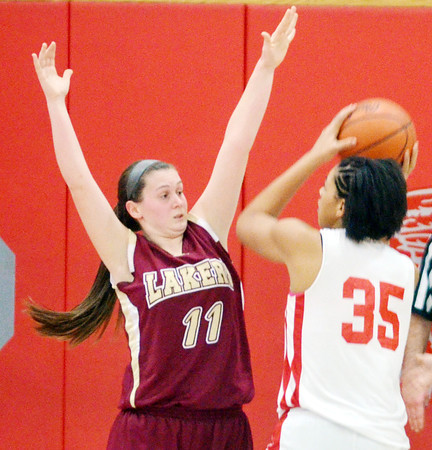 WARREN DILLAWAY / Star Beacon<br /> TAYLOR LIPINSKY (11) of Pymatuning Valley defends Katie Hall (35) of Edgewood on Monday at Edgewood.