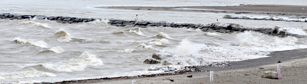 WARREN DILLAWAY / Star Beacon<br /> WAVES POUND the beach at Conneaut Township Park on Monday morning.