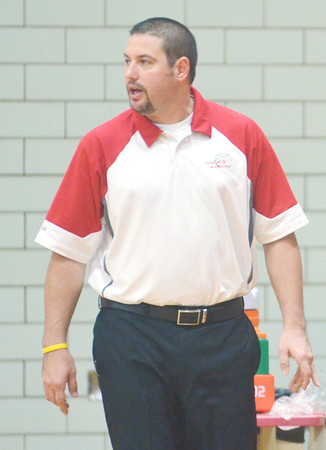 WARREN DILLAWAY / Star Beacon<br /> STEVE KRAY, Edgewood girls basketball coach, instructs   his team on Monday night during a home game with Pymatuning Valley.