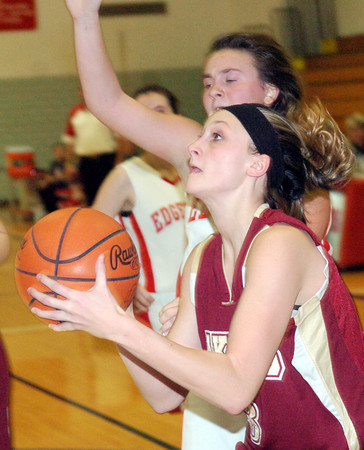 WARREN DILLAWAY / Star Beacon<br /> KELSEA BROWN of Pymatuning Valley drives to the basket on Monday evening at Edgewood.