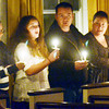 WARREN DILLAWAY / Star Beacon<br /> WORSHIPPERS HOLD lit candles during a Christmas Eve service at First Covenant Church in Saybrook Township.