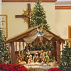 WARREN DILLAWAY / Star Beacon<br /> A NATIVITY scene and lit Christmas trees set the stage for worship at Our Lady of Peace Mount Carmel on Christmas morning.
