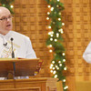 WARREN DILLAWAY / Star Beacon<br /> MICHAEL GARDNER reads the Bible during a Christmas Day Mass at Our Lady of Peace Mount Carmel in Ashtabula.