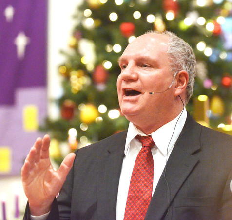 WARREN DILLAWAY / Star Beacon<br /> REV. BRUCE WYAND preaches during a Christmas Eve service at First Covenant Church in Saybrook Township.