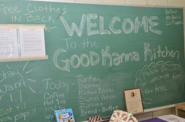 WARREN DILLAWAY / Star Beacon<br /> A CHALK board welcome dtails the ministry of Good Karma Kitchen at Our Lady of Peace St. Joseph.