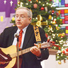 WARREN DILLAWAY / Star Beacon<br /> TIM MCCARTHY plays his guitar and sings during a Christmas Even Service at First Covenant Church in Saybrook Township.