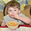 WARREN DILLAWAY / Star Beacon<br /> JONAHTAN WOLFGANG, 2, of Conneaut enjoys a Christmas meal at Good Karma Kitchen at Our Lady of Peace St. Joseph in Ashtabula on Wednesday.