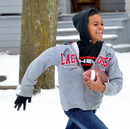 WARREN DILLAWAY / Star Beacon<br /> KEITH GEORGE, 11, of Ashtabula runs for a touchdown during a game of pick-up football on West 57th Street in Ashtabula on Thursday afternoon.