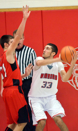 WARREN DILLAWAY / Star Beacon<br /> ELI KALIL (33) of Edgewood prepares to shoot as Lucas Hitchcock of Jefferson defends on Friday night at Edgewood.