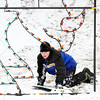 WARREN DILLAWAY / Star Beacon<br /> CALEB SUMMERS, 9, of Ashtabula, stops just short of a lighting display during sled riding at Lake Shore Park on Friday afternoon.