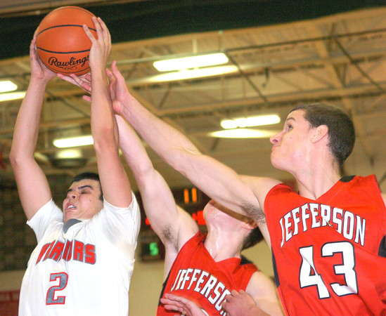 WARREN DILLAWAY / Star Beacon<br /> CONNOR MCLAUGHLIN (2) of Edgewood grabs the ball as David Chase (43) and Sam Caskey (center), both of Jefferson, reach for the ball on Friday night aaat Edgewood.