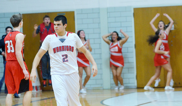 WARREN DILLAWAY / Star Beacon<br /> CONNOR MCLAUGHLIN (2) of Edgewood reacts after hitting a game tying three pointer with no time left on the clock to send the game into overtime as the  Warrior cheerleaders celebrate.