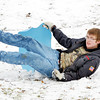 WARREN DILLAWAY / Star Beacon<br /> KEVIN THOMAS, 14, of Ashtabula, loses his sled at Lake Shore Park on Friday afternoon.