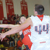 WARREN DILLAWAY / Star Beacon<br /> SAGE CANTINI of Jefferson tries to get a shot by Matt Fitchet of Edgewood (44) on  Friday night at Edgewood.