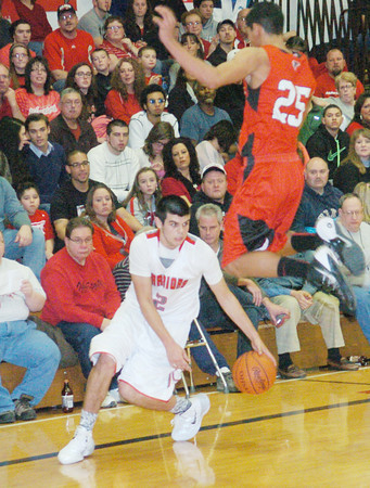 WARREN DILLAWAY / Star Beacon<br /> CONNOR MCLAUGHLIN (2) of Edewood moves around a flying James Jackson of Jefferson on Friday night at Edgewood.