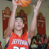 WARREN DILLAWAY / Star Beacon<br /> JAMES JACKSON of Jefferson drives to the basket on Friday night at Edgewood.