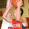 WARREN DILLAWAY / Star Beacon<br /> ANTHONY MONDA (22) of Edgewood prepares to block a shot by Lucas Hitchcock of Jefferson (31) on Friday night at Edgewood.