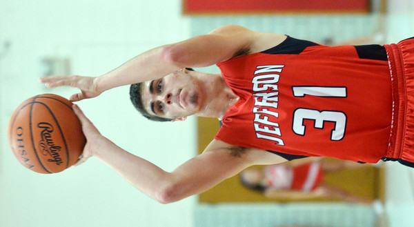 WARREN DILLAWAY / Star Beacon<br /> LUCAS HITCHCOCK of Jefferson shoots a foul shot on Friday night at Edgewood.