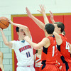 WARREN DILLAWAY / Star Beacon<br /> JOEY ZAPPITELLI (11 left) of Edgewood prepares to pass with Sage Cantini (center 11) and David Chase (43) of Jefferson defending on Friday night at Edgewood.