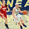 WARREN DILLAWAY / Star Beacon<br /> BROOKE BENNETT of Conneaut leads a break as Taylor Erskine (14) of Ledgemont follows the play on Saturday during the Conneaut Holiday Tournament.