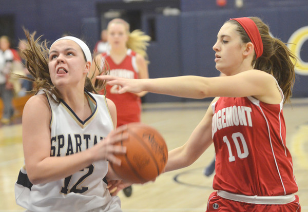 WARREN DILLAWAY / Star Beacon<br /> BROOKE BENNETT of Conneaut (left) drives to the basket as Alivia Sidley (10) of Ledgemont defends on Saturday during the Conneaut Holiday Tournament.