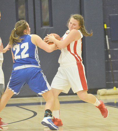 WARREN DILLAWAY / Star Beacon<br /> GIA SATURDAY  (right)  of Edgewood battles for the ball with Alexis Cassesa of Grand Valley on Saturday during the Conneaut Holiday Tournament.