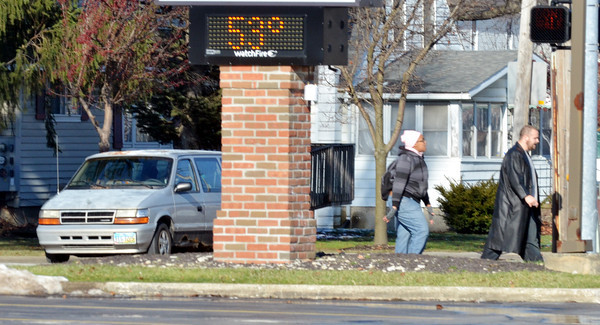 WARREN DILLAWAY / Star Beacon<br /> BANK THERMOMETERS registered temperatures in the mid -50s by early Saturday afternoon. The Andover Bank clock showed a temperature of 53 degrees along Route 534 in Geneva.