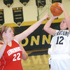 WARREN DILLAWAY / Star Beacon<br /> BROOKE BENNETT (12) of Conneaut prepares to shoot asss Carysa Cantrell of Ledgemont (22) defends on Saturday night during the Conneaut Holiday Tournament at Garcia Gymnasium.