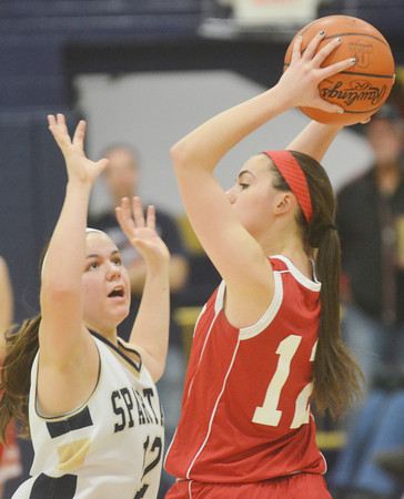WARREN DILLAWAY / Star Beacon<br /> BROOKE BENNETT (left) of Conneaut defends Amelia Sidley of Ledgemont on Saturday evening during the Conneaut Holiday Tournament.
