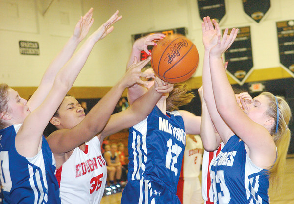 WARREN DILLAWAY /Star Beacon<br /> IESHA NICIU (35) of Edgewood battles for the ball with Grand Valley's Katie Futty (far left), Jessica Vormelker (12) and Shar Miller (33) on Saturday during the Conneaut Holiday Tournament.