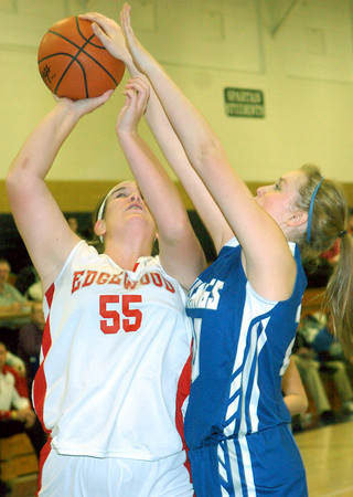 WARREN DILLAWAY / Star Beacooon<br /> KATTIE FUTTY (right) of Grand Valley tries to block a shot by Cortney Humphhrey (55) of Edgewood on Saturday during the Conneaut Holiday Tournament.