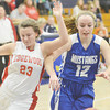 WARREN DILLAWAY / Star Beacon<br /> GIA SATURDAY (left) of Edgewood and Jessica Vormelker of Grand Valley battle for the  ball on Saturday night during the Conneaut Holiday Tournament at Garcia Gymnasium.