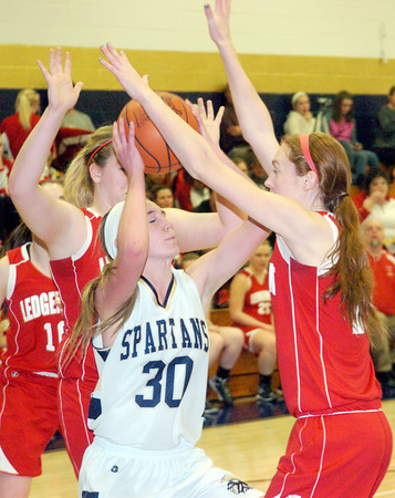 WARREN DILLAWAY / Star Beacon<br /> LEXI ZAPPITELLI (30) of Conneaut gets stuck between Ledgemont defenders Carysa Cantrell (left middle) and Taylor Erskine on Saturday during the Conneaut Holiday Tournament.