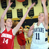 WARREN DILLAWAY / Star Beacon<br /> TAYLOR ERSKINE (14) of Ledgemont and Angela Cole of Conneaut battle for the ball on Saturay night during the Conneaut Holiday Tournament.