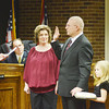 WARREN DILLAWAY / Star Beacon<br /> KRIS HAMRICK (center arm raised) takes the Ashtabula City Council oath of office from Ashtabula Municipal Court Judge Albert Camplese (left) with daughter Gabriella Hamrick holding the Bible and wife Jenifer Hamrick and son Douglas Winters (right) looking on Monday night in Ashtabula City Council chambers.