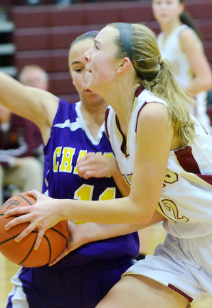 WARREN DILLAWAY / Star Beacon<br /> REBECCA DILLON (with ball) of Pymatuning Valley drives to the basket with Alex Steigerweld of Champion on Monday evening in Andover Township.