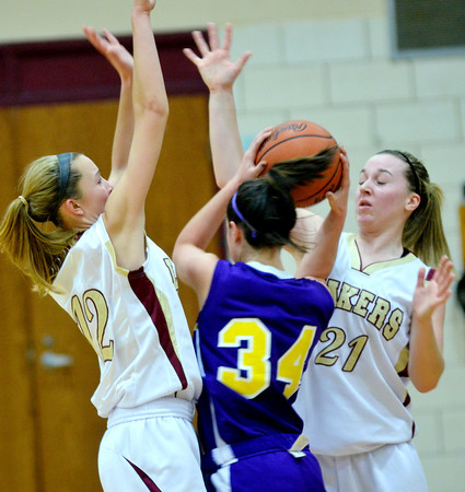 WARREN DILLAWAY / Star Beacon<br /> REBECCA DILLON (12) and Pymatuning Valley Geena Gabriel (21) surround Emma Nichols of Champion on Monday in Andover Township.