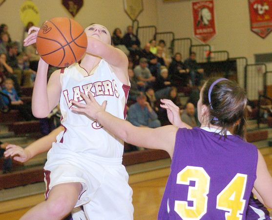 WARREN DILLAWAY / Star Beacon<br /> OLIVIA HOLDEN of Pymatuning Valley loses the ball as Emma Nichols (34) of Champion defends on Monday evening in Andover Township.