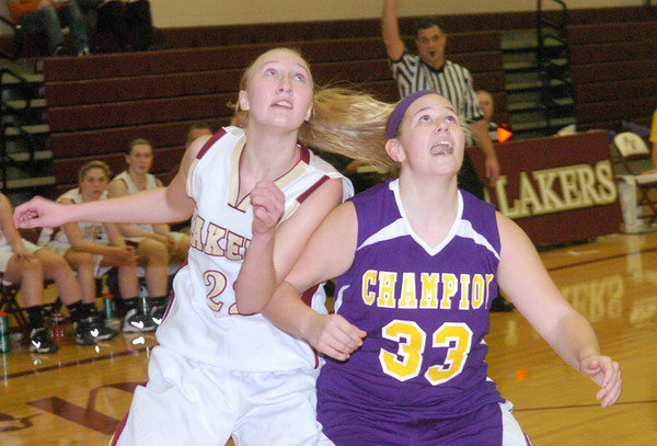 WARREN DILLAWAY / Star Beacon<br /> MEGAN STECH (22) of Pymatuning Valley and Kelly Robinson (33) of Champion battle for position on Monday evening in Andover Township.