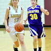 WARREN DILLAWAY / Star Beacon<br /> REBECCA DILLON (12) of Pymatuning Valley leads a fast break with  Izzy D'urso of Champion following the play on Monday in Andover Township.