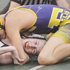 WARREN DILLAWAY / Star Beacon<br /> JOSH PERRY (center facing) of Lakeside tries to stay off his back while wrestling Cody Adkins of Euclid on Tuesday evening at Lakeside.