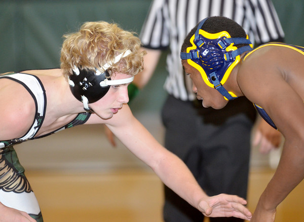 WARREN DILLAWAY / Star Beacon<br /> MICHAEL COUP (left) of Lakeside wrestles Kevin Leonard during a 170 pound bout at Lakeside on Tuesday evening.