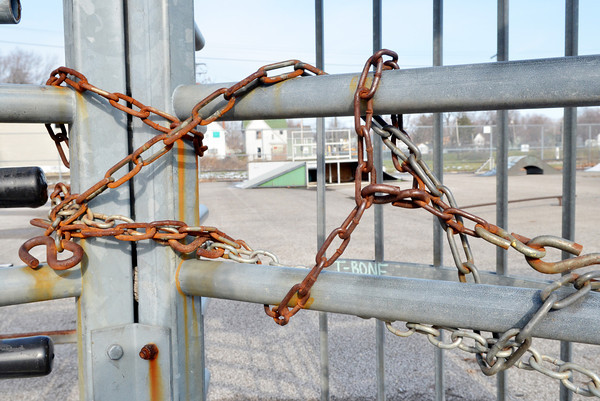 WARREN DILLAWAY / Star Beacon<br /> CHAINS LOCK the gate to The Cage Skate Park in Conneaut.