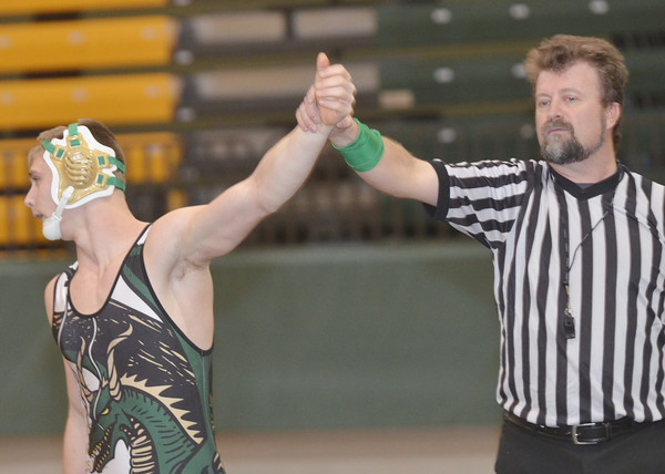 WARREN DILLAWAY / Star Beacon<br /> JOSEPH KANGAS of Lakeside is declared the victor by referee Bob Ziefle following a 152 pound bout on Tuesday evening at Lakeside.