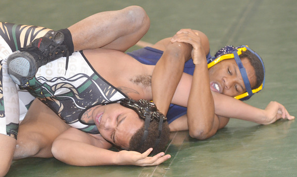 WARREN DILLAWAY / Star Beacon<br /> DA' SEAN HATFIELD (left) of Lakeside tries to escape the grasp of Reggie Phillips of Euclid on Tuesday during a 160 pound bout at Lakeside.