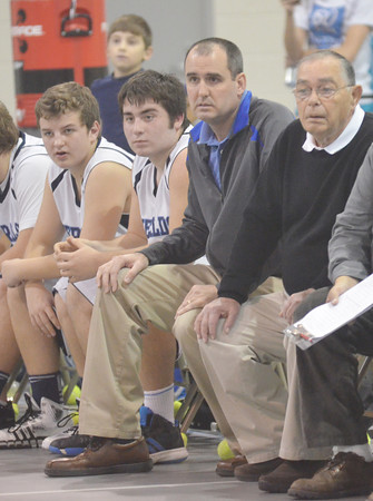 WARREN DILLAWAY / Star Beacon<br /> JON HALL, St. John boys basketball coach,  (right) and assistant coach Steve Juncker watch the action on Tuesday evening during