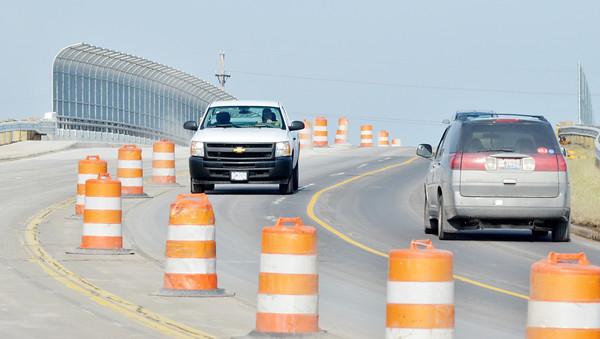 WARREN DILLAWAY / Star Beacon<br /> ORANGE BARRELLS are expected to disappear from the West Avenue Overpass north of Route 20 as the job is nearing completion.