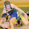 WARREN DILLAWAY / Star Beacon<br /> JOSH PERRY (top) of Lakeside wrestles Cody Adkins of Euclid during a 132 pound bout on Tuesday evening at Lakeside.