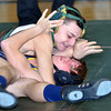 WARREN DILLAWAY / Star Beacon<br /> TYLER NEWSOME of Lakeside (top) goes for the pin on Tuesday evening during a 120 poud bout with Quintin Rosenlund of Euclid at Lakeside.