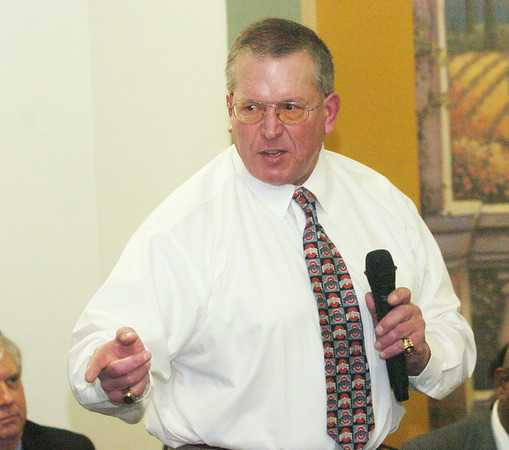 WARREN DILLAWAY / Star Beacon<br /> GARY LILLVIS, Harbor 1971, encourages high school football players during his induction speech for the Ashtabula County Football Hall of Fame Monday evening at Mount Carmel Community Center.